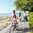 Stock Photo: Happy asian family riding bikes in the beautiful morning at the