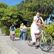 Happy asian family riding bikes in the beautiful morning at the — Stock Photo #31746361