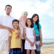 Smiling happy asian family at the beach together — Stock Photo
