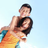 Happy kids having fun doing piggyback ride — Stock Photo