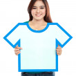 Asian young girl holding t-shirt symbol — Stock Photo #32015069
