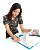 Portrait of a young businesswoman working with papers in office — Stock Photo
