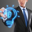 Business man drawing idea light bulb — Stock Photo