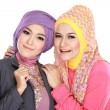 Portrait of two beautiful muslim woman having fun — Stockfoto