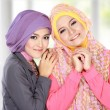 Stock Photo: Portrait of two beautiful muslim womhaving fun