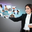 Businesswoman holding smartphone and using digital touchscreen t — Stock Photo #32874957