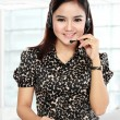 Businesswoman in office place communicate by wireless headset — Stock Photo