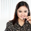 Friendly help desk woman smiling call center operator phone  — Stock Photo