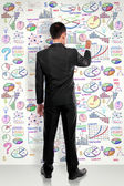 Full lenght businessman drawing modern business concept on white — Foto Stock