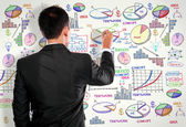 Businessman drawing modern business concept on white — Foto Stock