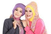 Portrait of two beautiful muslim woman having fun — Stock Photo