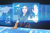 Businesswoman dragging an icon on a touch screen monitor — Stock Photo
