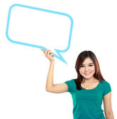 Young girl holding blank text bubble in specs — Foto Stock