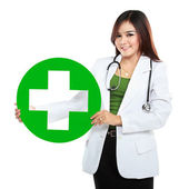 Young woman doctor holding medical sign — Stock Photo