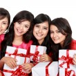 Happy four asian woman with christmas santa hat holding gift box — Stock Photo