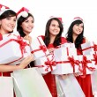 Happy funny people with christmas santa hat holding gift boxes a — Stock Photo #34918767