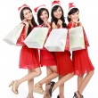Happy funny people with christmas santa hat holding gift boxes a — Stock Photo