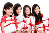 Happy beautiful four asian woman with christmas santa hat holdin — Stock Photo