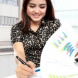 Stock Photo: Young businesswomworking with papers in office