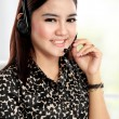 Businesswoman communicate by wireless headset — Stock Photo