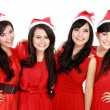 Happy young four asian woman with christmas santa hat — Stock Photo #34929703