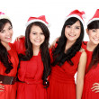 Happy young four asian woman with christmas santa hat — Lizenzfreies Foto