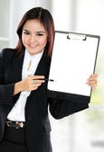 Business woman showing blank clipboard — Stock Photo