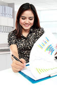 Young businesswoman working with papers in office — Stok fotoğraf