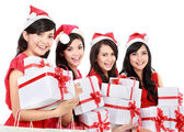 Happy funny people with christmas santa hat holding gift boxes — Stock Photo