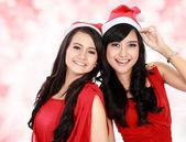 Beautiful two girls in christmas santa hat have fun — Stock Photo