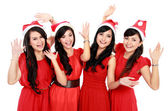 Happy funny people with christmas santa hat — Stock Photo