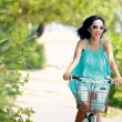 Woman having fun riding bicycle at the beach — Stock Photo