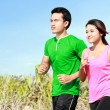 Young couple running together — Stock Photo