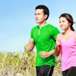 Stock Photo: Young couple running together