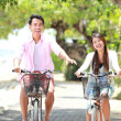 Stock Photo: Young couple riding bicycle together