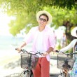 Young couple portrait with bicycle on the beach — Stock Photo