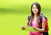 Asian student smiling on park — Stock Photo
