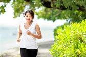 Girl jogging on the beach — Stock Photo