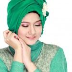 Fashion portrait of young beautiful muslim woman with green cost — Zdjęcie stockowe