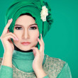 Fashion portrait of young beautiful muslim woman with green cost — Stock Photo #36860711