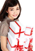 Young happy woman with gift box — Stock Photo