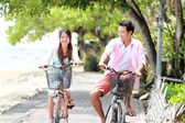 Young couple riding bicycle together — Stock Photo