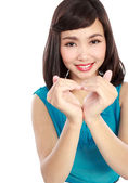 Woman in love showing heart symbol — Stock fotografie