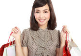 Shopping woman happy smiling holding shopping bags — Stock Photo