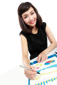 Business woman working on her desk — Stock Photo