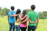 Group of people holding each other — Stock Photo