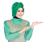 Young moslem woman presenting — Photo