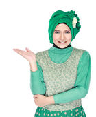 Young moslem woman presenting — Stock Photo