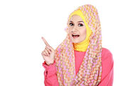 Young moslem woman pointing — Stockfoto
