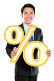 Attractive businessman holding percent sign — Stock Photo